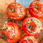 five baked tomatoes stuffed with millet and herbs