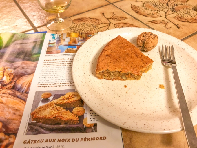 A magazine featuring a French walnut cake recipe next to a walnut cake slice.