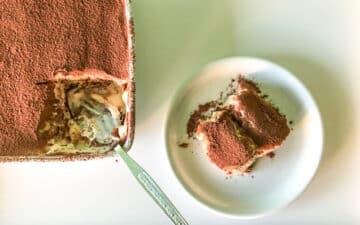 A slice of low fodmap tiramisu taken from an oven dish