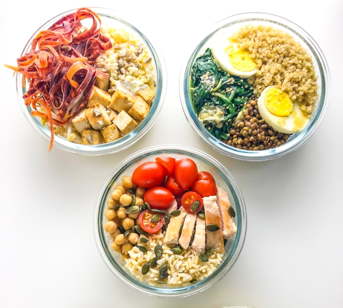 three round nourish bowls packed with different veggies, grains and protein