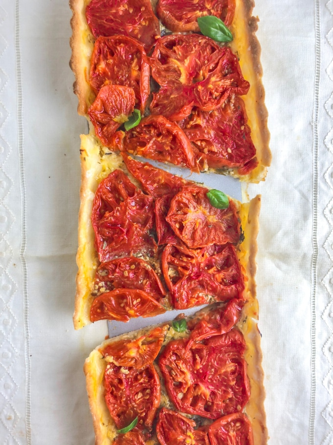 A rectangular shaped tomato tart cut in three
