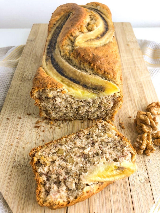 Sliced banana nut bread on a cutting board