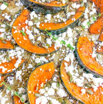 Detailed image of roast pumpkin wedges with feta and thyme leaves