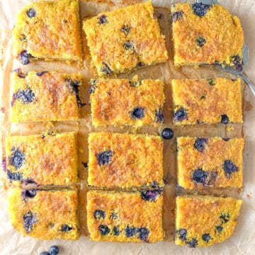 a square carrot and orange cake cut in squares