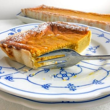 A pumpkin pie slice, cut with a fork