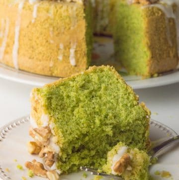 slice of green cake and cake on the background